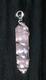 Кристалл розового кварца оплетенный в серебро.
